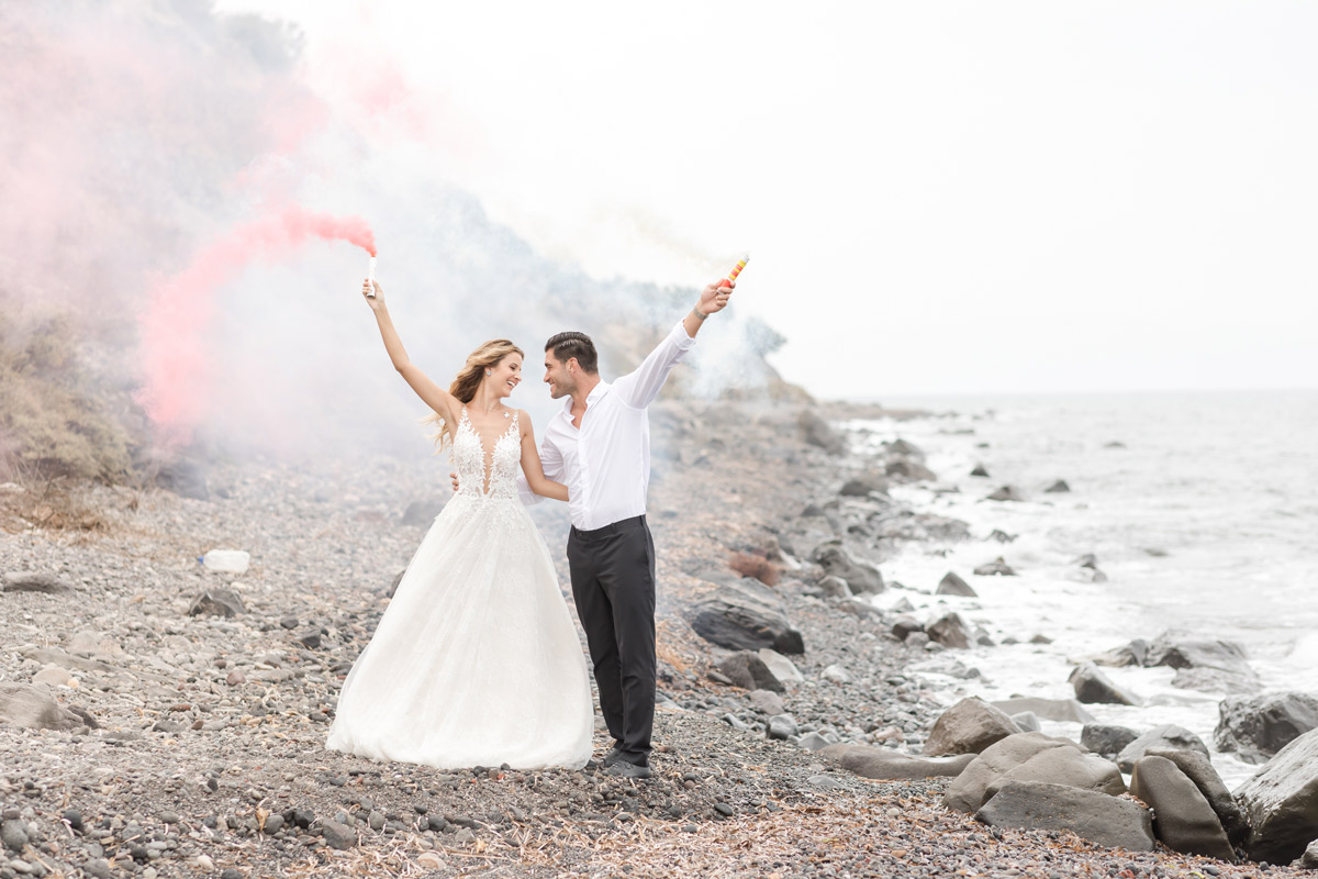 a_silver_crescent_elopement_in_Santorini_at_the_beach.jpg